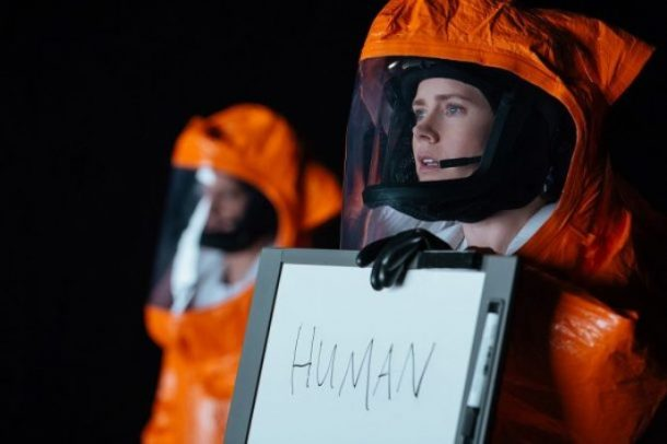arrival-amy-adams-holds-human-sign-610x406